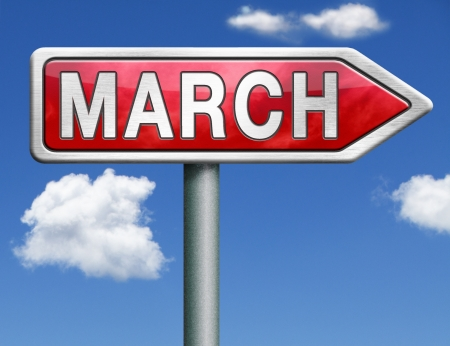 March pointing to next month of the year spring road sign arrow photo