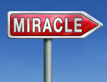 miracle: miracle make dream come true wonder by Jesus or God when you have faith red road sign arrow with text word concept