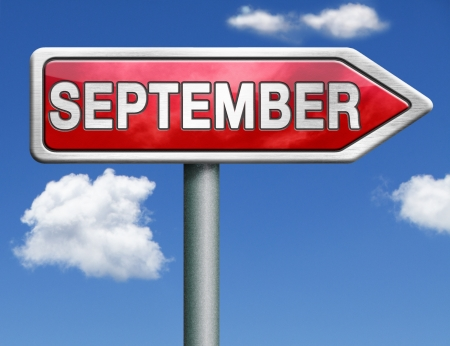 September pointing to next month of the year summer road sign arrow photo