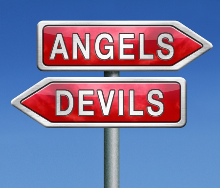 angels and devils choice between heaven and hell raod sign arrow with text photo