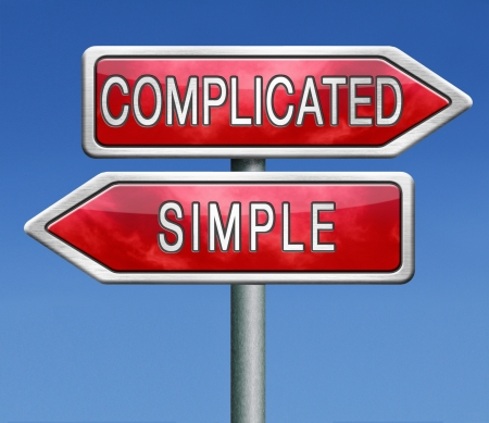 hard way: complicated or simple the easy or the hard way roadsign arrow on blue background crossroads
