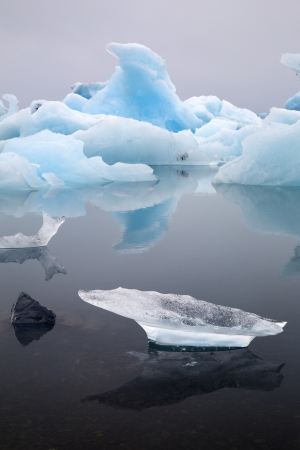 Iceberg landscape Iceland at Joulsarlon glacier lagoon drifting pack ice due to melting caused by global warming beautiful artic travel and tourism location cold wilderness photo