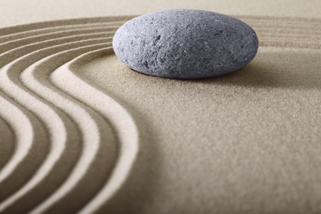 zen garden japanese garden zen stone with raked sand and round stone tranquility and balance ripples sand pattern Reklamní fotografie - 22661180