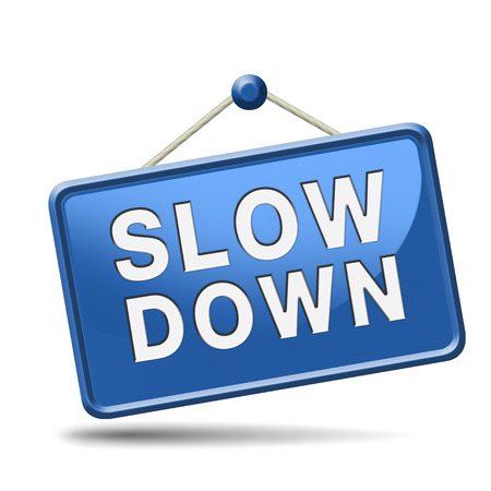race for time: Slow down and take it easy and slowly. Blue placard. Stock Photo