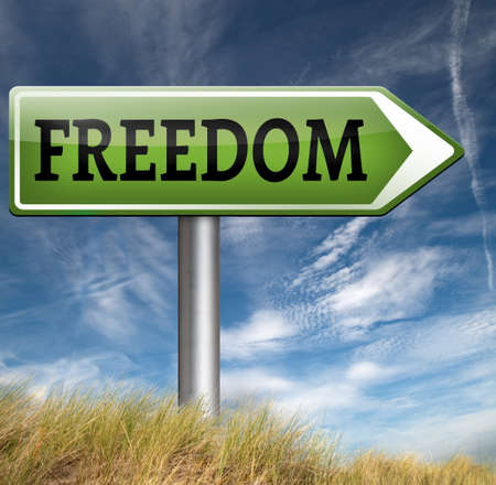 obligations: freedom road sign peaceful free life without restrictions or obligations and peace democracy with text and word concept  Stock Photo