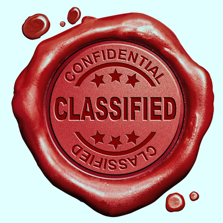 classified: classified confidential information secret info red wax seal stamp button Stock Photo