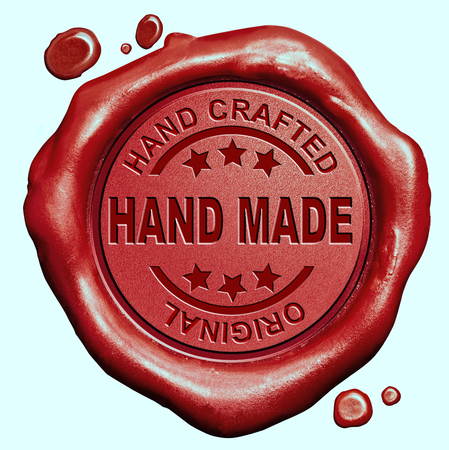 one of a kind: hand made exclusive handmade hand craft custom crafted authentic one of a kind red wax seal stamp button Stock Photo