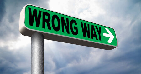 turn back: wrong way big mistake turn back getting lost by taking the wrong road Stock Photo