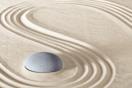 holistic health: spa treatment concept japanese zen garden stones tao buddhism conceptual for balance harmony relaxation meditation wellness background harmony and purity stone stack in sand pattern spiritual elements
