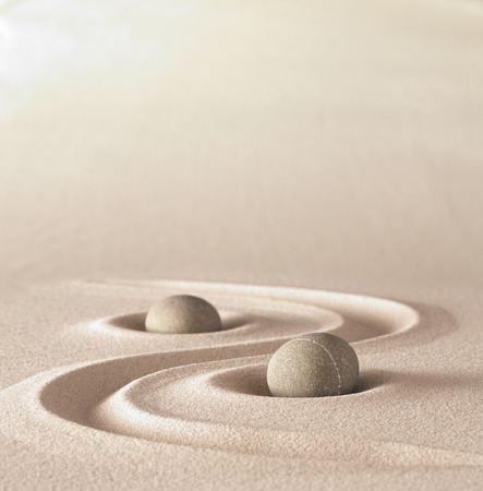 zen garden meditation stone background with copy space stones and lines in sand for relaxation balance and harmony spirituality or spa wellness