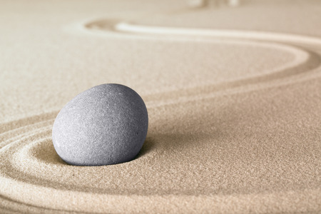 zen stones: Japanese zen garden stone with lines in sand. Balance and harmony for relaxation and meditation.