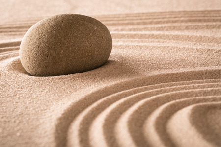 spirituality: spirituality stone and lines in sand, Japanese garden for balance harmony purity and spiritual guidance rock background Stock Photo