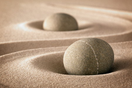 purity and spirituality in the harmony of a zen garden stones and lines in sand for concentration and relaxation pure nature or spa wellness background