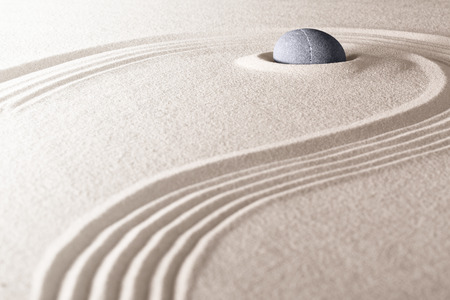 zen stone and sand garden. Concept for relaxation meditation purity spirituality and balance. Rock and lines spa wellness background