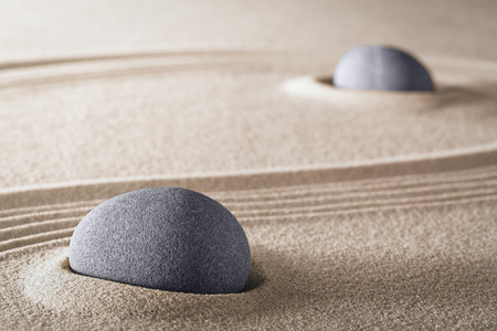 purity: purity zen meditation garden round stones and lines in sand for meditation relaxation harmony and spirituality Stock Photo