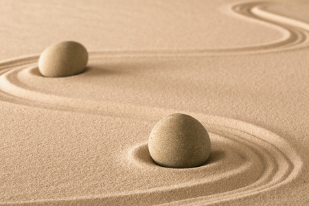 purity: zen stones and lines in sand of Japanese garden. Purity harmony and balance.