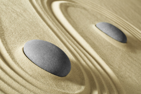 massage stone: wellness and zen meditation background stones adn lines in sand for balance harmony and relaxation spa massage stone, spirituality and purity