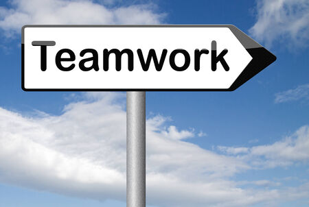 teambuilding: teamwork  road sign  team work and cooperation in partnership working together business partners