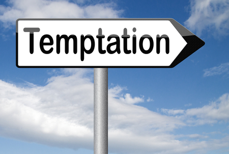 resisting: temptation resist devil temptations lose bad habits by self control Stock Photo