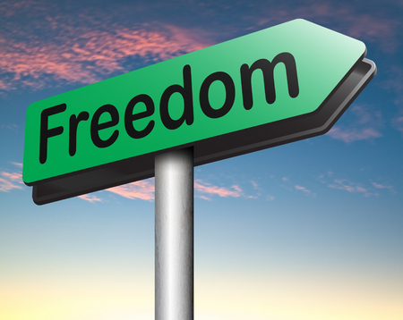 obligations: freedom road sign peaceful free life without restrictions or obligations and peace democracy with text and word concept
