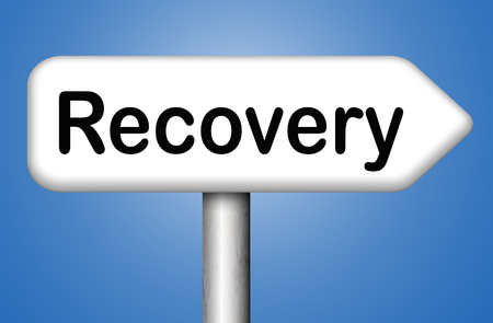 road to recovery: econimic recovery recover lost data or from crisis and recession road sign