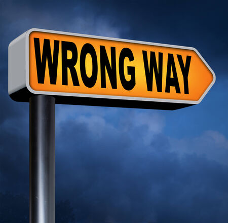 wrong way: wrong way big mistake turn back getting lost by taking the wrong road Stock Photo
