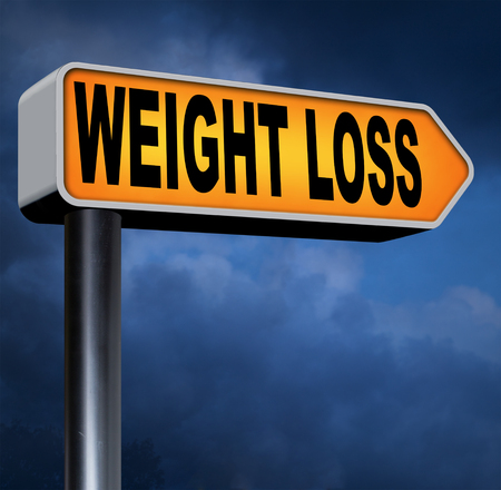 kilos: weight loss loosing extra kilos by exercise sport and a healthy diet Stock Photo