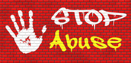 pedophilia: stop abuse child protection prevention from domestic violence and neglection end abusing children grafitty on red brick wall, text and hand Stock Photo