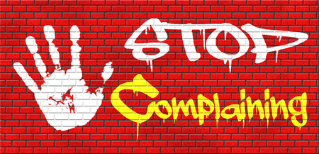 complaining: stop complaining dont complain no negativity accept fate destiny responsibility facts and consequences accepting position grafitty on red brick wall, text and hand Stock Photo