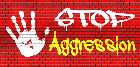 aggression: stop aggression and violence bring peace and stop the fighting and hostility grafitty on red brick wall, text and hand Stock Photo