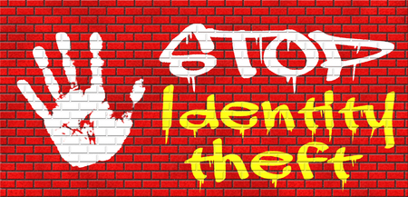 id theft: identity theft stop warning sign stealing ID online is an internet or cyber crime grafitty on red brick wall, text and hand