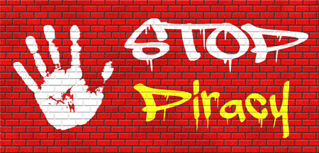 intellectual property law: piracy stop illegal download of movies and music and illegal copying copyright and intellectual property protection protect copy of trademark brand grafitty on red brick wall, text and hand Stock Photo