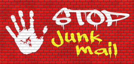 junk mail: stop junk mail and spam grafitty on red brick wall, text and hand