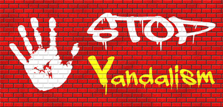stop vandalism deliberate destruction of or damage to public or private property grafitty on red brick wall, text and hand