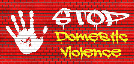 domestic violence abuse or aggression within marriage against partner wife or children grafitty on red brick wall, text and hand photo