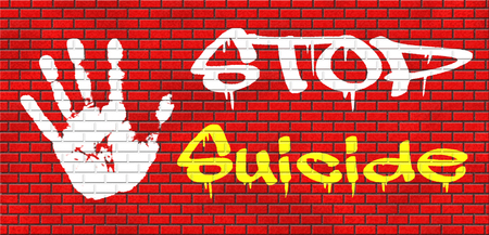 suicidal: suicide prevention campaign to help suicidal people grafitty on red brick wall, text and hand Stock Photo