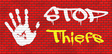 armed robbery: catch thiefs stop theft no robbery or pick pocket thief arrest by police investigation or neighborhood watch online internet thief grafitty on red brick wall, text and hand