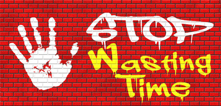 wasting: stop wasting time no minute lost or waste act now the hour of action grafitty on red brick wall, text and hand Stock Photo