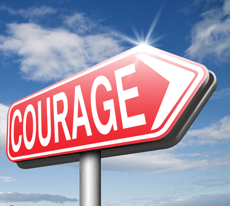 confront: courage no fears and bravery the ability to confront fear pain danger uncertainty and intimidation fearless courageous road sign arrow Stock Photo