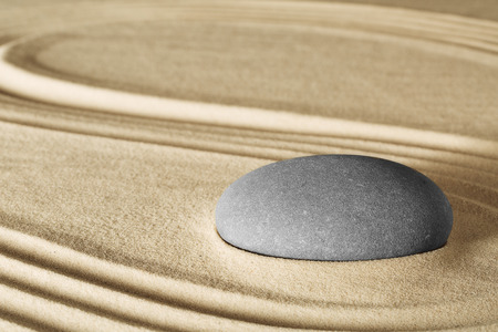 spirituality therapy: spiritual zen meditation in Japanese rock garden concept for harmony balance simplicity sand and pebble tao or Buddhism spa wellness massage stone therapy background Stock Photo