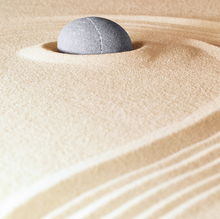 copy sapce: zen stone background sand lines for balance relaxation and meditation concept for purity spirituality serenity calmness peaceful harmony simplicity relax copyspace