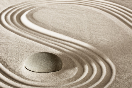 zen: spa treatment concept japanese zen garden stones tao buddhism conceptual for balance harmony relaxation meditation wellness background harmony and purity stone stack in sand pattern spiritual elements