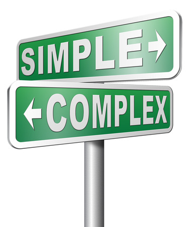 simple or complex easy versus complicated or difficult road sign arrow photo