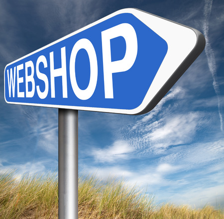 webshop: webshop online shopping at internet web shop buy and sell onine road sign arrow Stock Photo