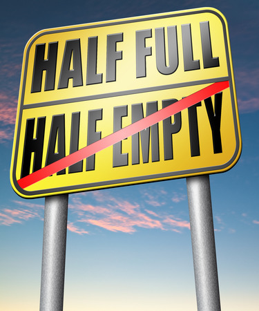 half full: half full or empty think positive not negative optimistic versus pessimistic look at the bright side not the dark Stock Photo