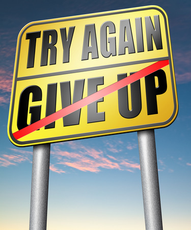 believing: try again give up keep going and trying never stop believing in yourself road sign