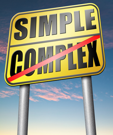 simple or complex simplicity and simplifying easy versus complicated or difficult road sign arrow photo