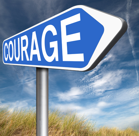 courage no fears and bravery the ability to confront fear pain danger uncertainty and intimidation fearless courageous road sign arrow Stock Photo