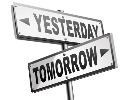 tomorrow: yesterday tomorrow live in the past or in the bright future time and date road sign