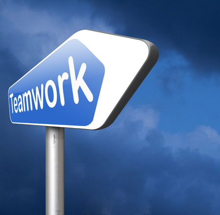 teambuilding: teamwork  road sign concept, team work and cooperation in partnership working together business partners